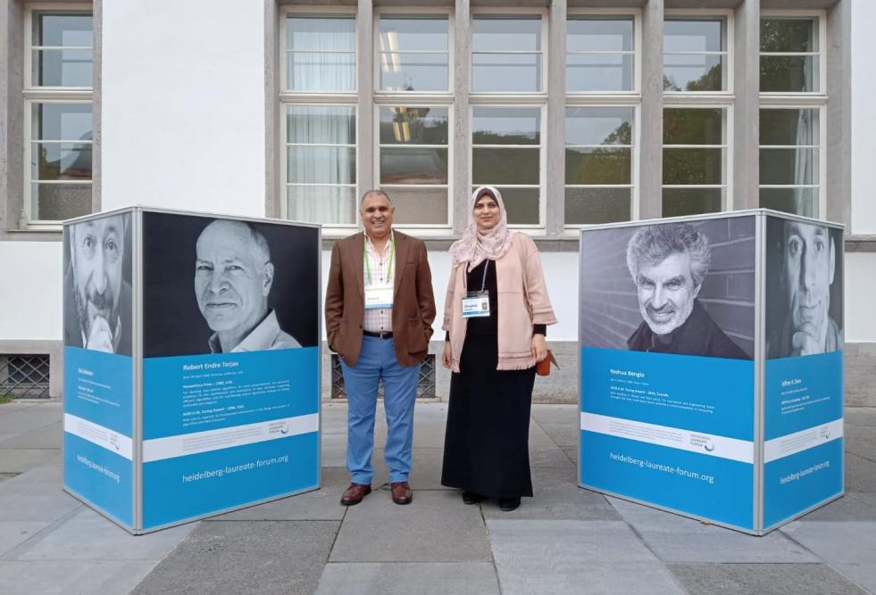 Ghadeer Abuoda, a College of Science and Engineering student in the company of Dr. Ahmed Elmagarmid, executive director of QCRI, at the Seventh Heidelberg Laureate Forum.